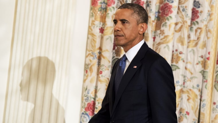 US President Barack Obama arrives to speak about the situation in Iraq in the State Dining Room at the White House in Washington, DC, August 7, 2014.
