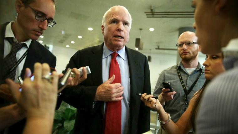 U.S. Sen. John McCain (R-AZ) talks to reporters after a closed door briefing June 4, 2014.