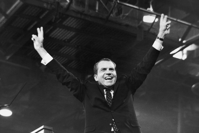 Richard Nixon gives the 'V' for victory sign after receiving the presidential nomination at the Republican National Convention, August 1968, in Miami, Fla.