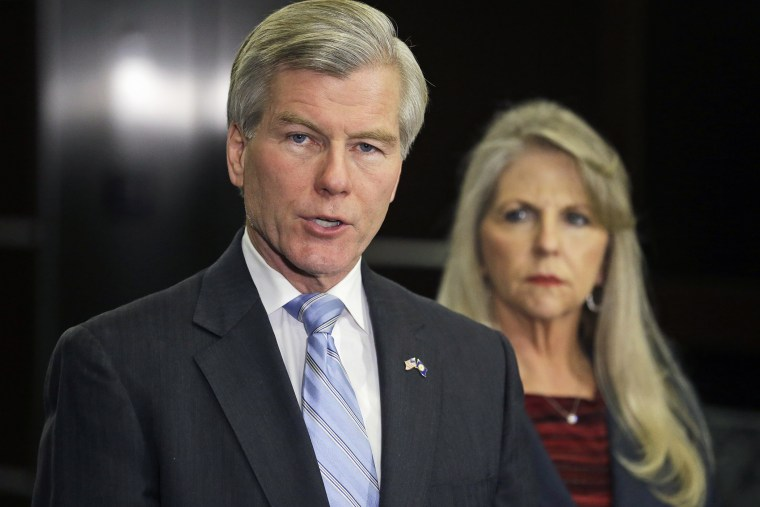 Former Virginia Gov. Bob McDonnell makes a statement as his wife, Maureen, listens during a news conference in Richmond, Va., Jan. 21, 2014.