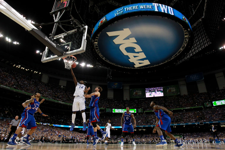 The NCAA logo is seen as the Kentucky Wildcan as the Kentucky Wildcats play against the Kansas Jayhawks in the first half in the National Championship Game of the 2012 NCAA Division I Men's Basketball Tournament on April 2, 2012 in New Orleans, Louisiana.