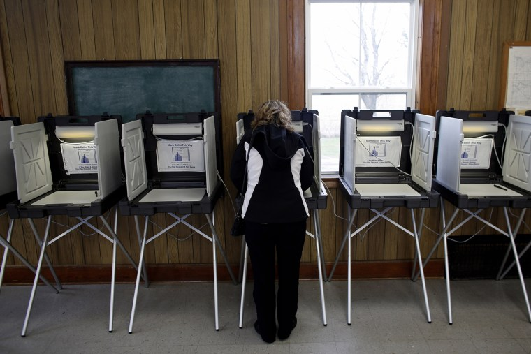 A woman casts her vote at a polling station on Nov. 6, 2012 in Sugar Creek, Wis.