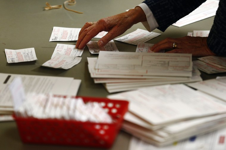 A poll worker looks at voter authorization forms in Charlotte, North Carolina.