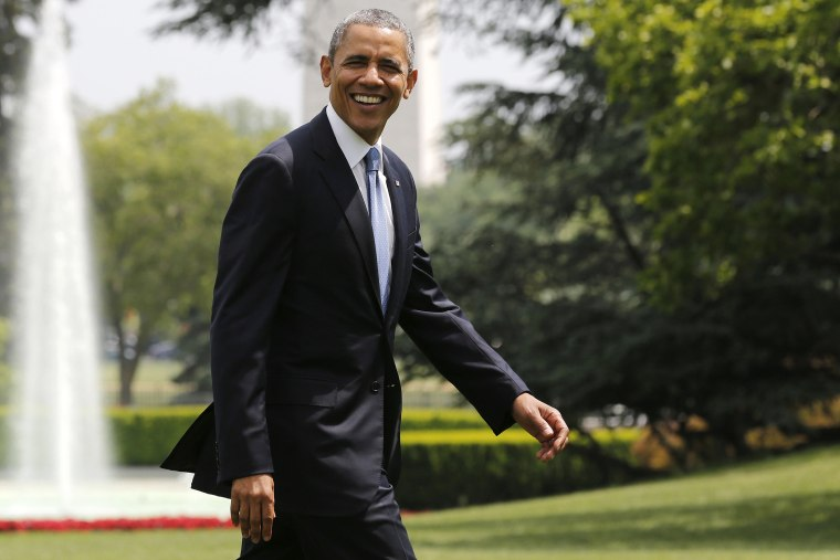 U.S. President Barack Obama smiles as he walks away from Marine One on the South Lawn at the White House in Washington, D.C., May 28, 2014.