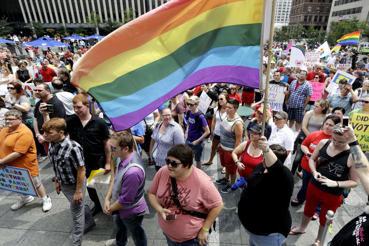 Hundreds of gay marriage supporters rally on Fountain Square, on Aug. 6, 2014, in Cincinnati. Three judges of the 6th U.S. Circuit Court of Appeals in Cincinnati are set to hear arguments Wednesday in six gay marriage fights from four states, Kentucky, Michigan, Ohio and Tennessee