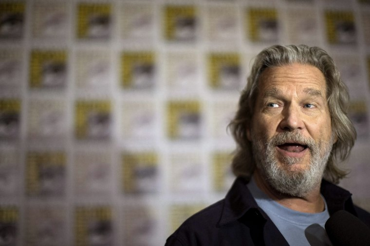 """Image: Cast member Bridges is interviewed at a press line for the movie """"The Giver"""" during the 2014 Comic-Con International Convention in San Diego"""