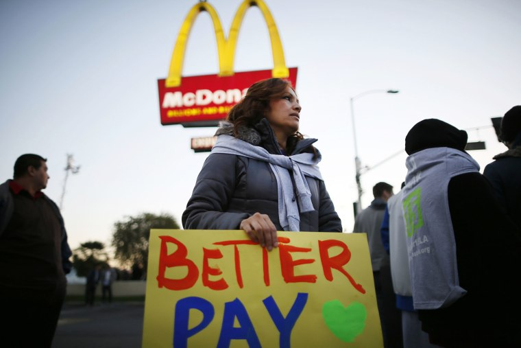 Protesters march outside McDonald's in Los Angeles, California, December 5, 2013.