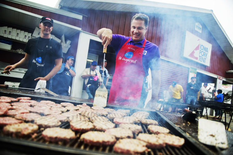 Senate candidate Rep. Bruce Braley, D-Iowa, helps out on the grill in the Pork Tent at the Iowa State Fair in Des Moines, August 7, 2014.