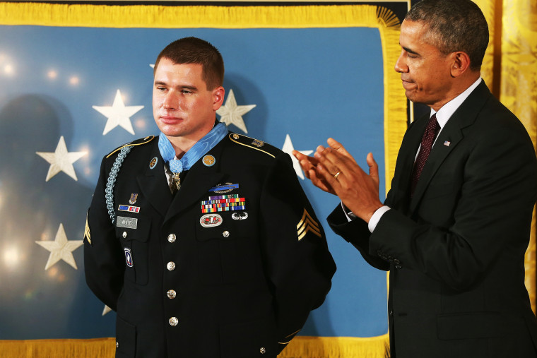 U.S. President Barack Obama applauds after presenting the Medal of Honor to U.S. Army Sgt. Kyle J. White during a ceremony in the East Room of the White House May 13, 2014 in Washington, DC.
