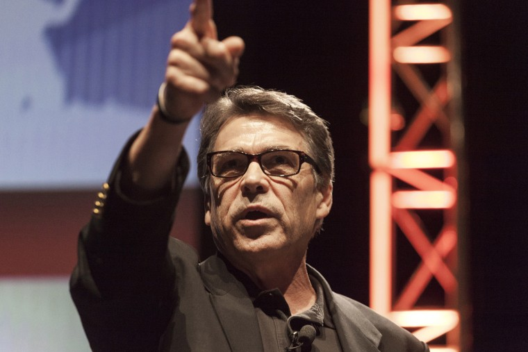 Texas Governor Rick Perry gestures as he speaks at the Family Leadership Summit in Ames, Iowa August 9, 2014.