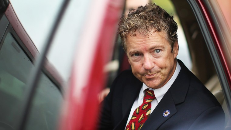 U.S. Sen. Rand Paul (R-KY) is questioned by a reporter as he leaves an event at the Iowa GOP Des Moines Victory Office on August 6, 2014 in Urbandale, Iowa.