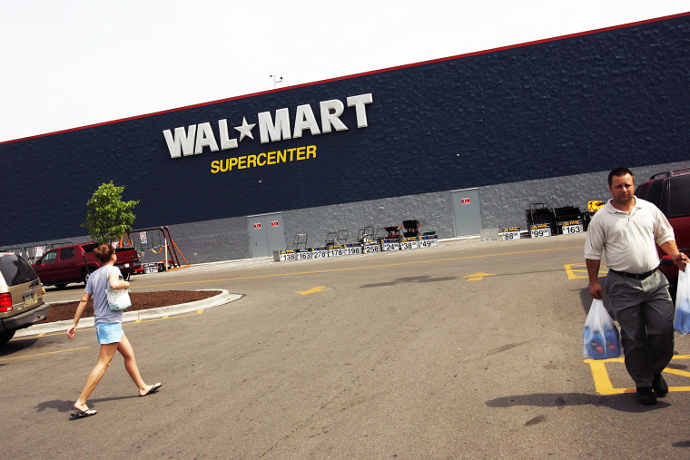 Shoppers walk in the parking lot of a Wal-Mart Supercenter in Troy, Ohio.