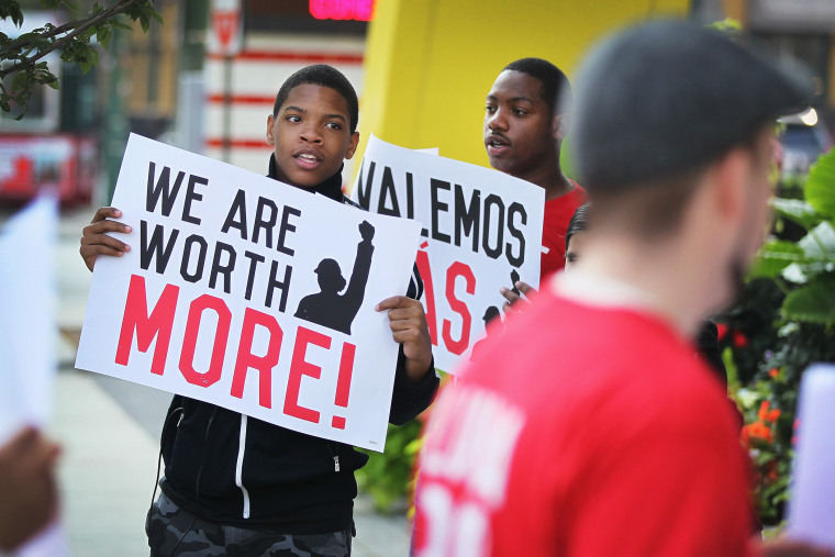 Fast food workers and activists demonstrate outside McDonald's downtown flagship restaurant on July 31, 2014 in Chicago, Illinois.