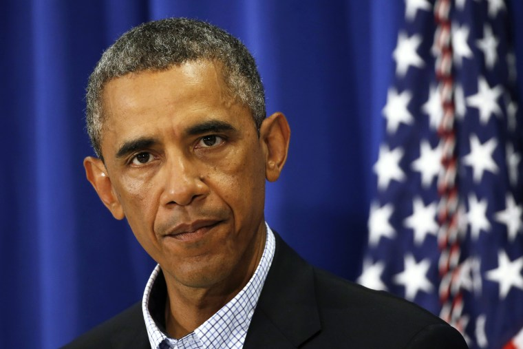 U.S. President Barack Obama speaks about Iraq and also the shooting in Ferguson, Missouri from his vacation on Martha's Vineyard, Massachusetts August 14, 2014.