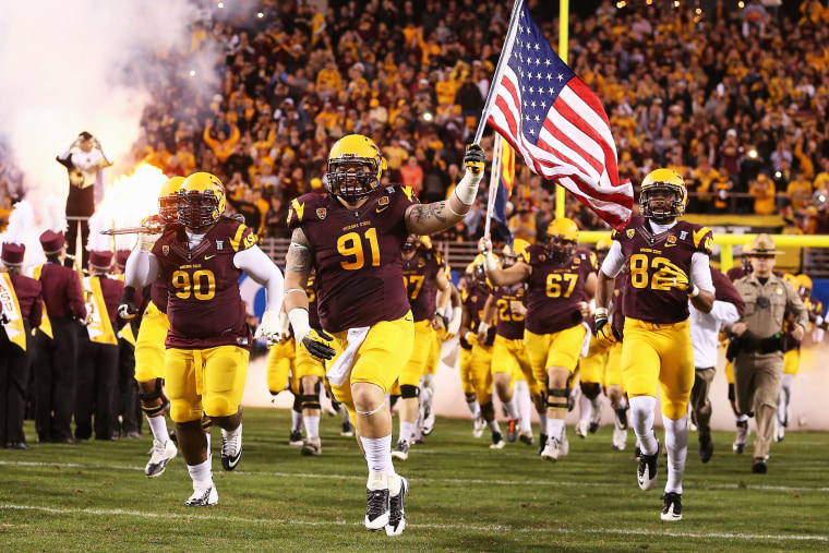 Arizona State Sun Devils players run out onto the field before a game against the Stanford Cardinals at Sun Devil Stadium on December 7, 2013.