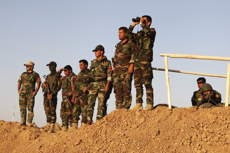 Kurdish peshmerga troops keep watch during an intensive security deployment against Islamic State militants on the frontline in Khazer August 14, 2014.