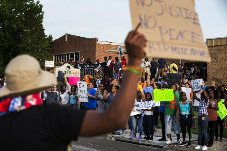 Demonstrators protest outside of Greater St. Marks Family Church in Ferguson, Missouri