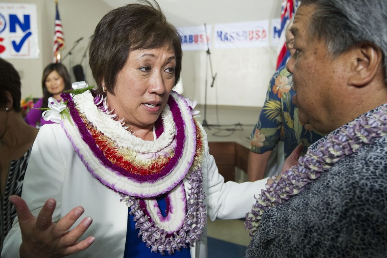 U.S. Rep. Colleen Hanabusa, Democrat, from Hawaii's 1st district, talks to former Hawaii Governor Ben Cayetano, right, at her campaign headquarters, Aug. 9, 2014, in Honolulu, Hawaii.
