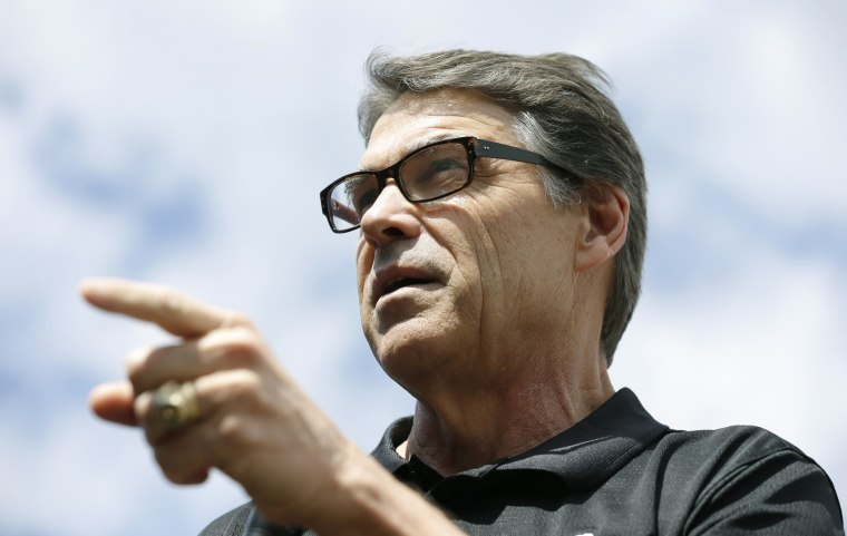 Texas Gov. Rick Perry speaks at the Des Moines Register's Political Soapbox at the Iowa State Fair, Tuesday, Aug. 12, 2014, in Des Moines, Iowa.