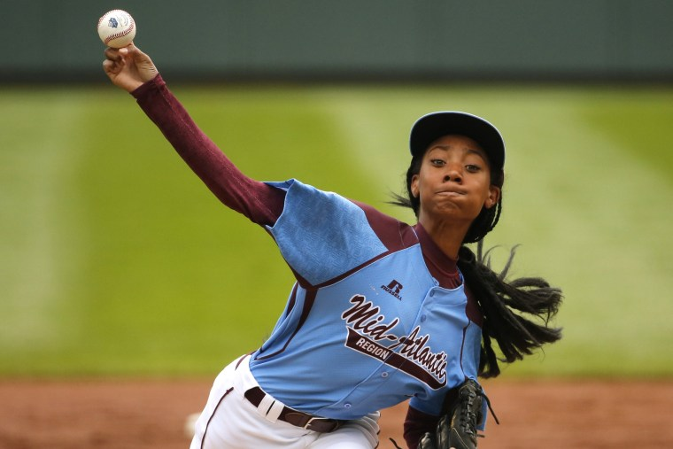 Pennsylvania's Mo'ne Davis delivers in the first inning against Tennessee during a baseball game in United States pool play at the Little League World Series tournament in South Williamsport, Pa., Friday, Aug. 15, 2014.