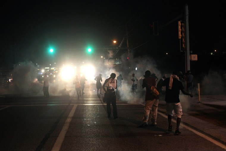 Tear gas and smoke wafts around the site of a protest of the death of Michael Brown Aug. 17, 2014 in Ferguson, Missouri.
