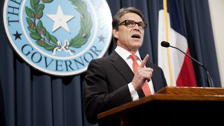 Texas Governor Rick Perry makes a statement regarding his grand jury indictment on charges of abuse of power at the Texas state capitol, in Austin, Texas on Aug. 16, 2014.
