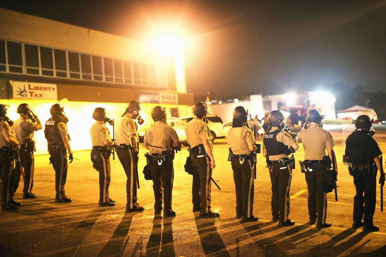 Police advance on demonstrators protesting the killing of teenager Michael Brown on August 17, 2014 in Ferguson, Missouri.