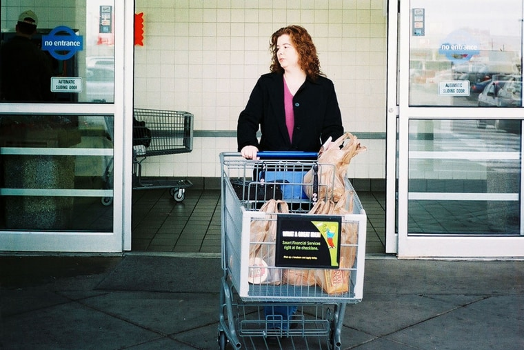 A woman exits a Kroger supermarket in Detroit.