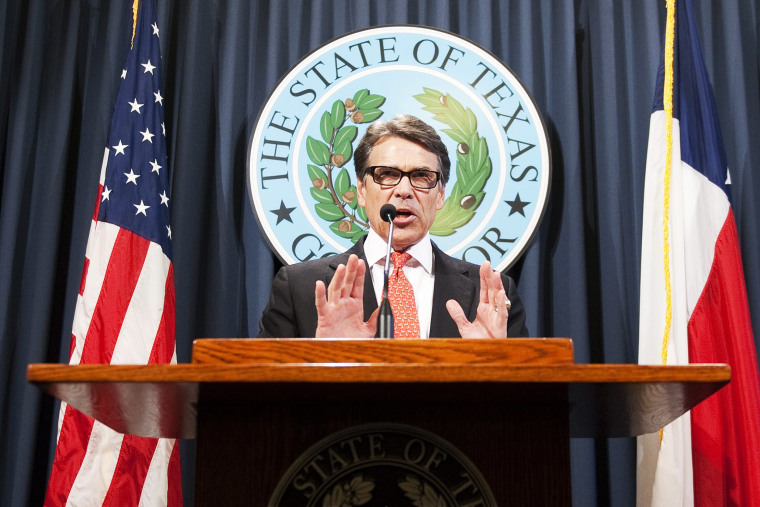 Texas Governor Rick Perry makes a statement regarding his grand jury indictment on charges of abuse of power at the Texas state capitol, August 16, 2014.