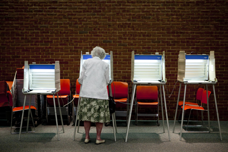 A voter casts her ballot in the primary election in Maryland Heights, Missouri, August 3, 2010.
