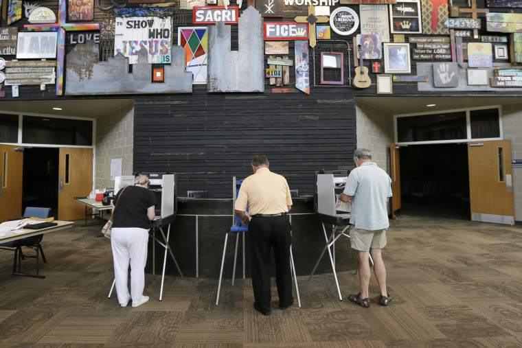 Voters fill out their ballots in Iowa's primary election, West Des Moines, Iowa, June 3, 2014.