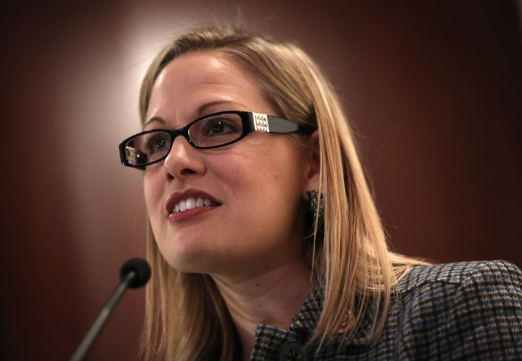 U.S. Rep. Kyrsten Sinema (D-AZ) speaks during a discussion on immigration reform October 23, 2013 on Capitol Hill in Washington, DC.