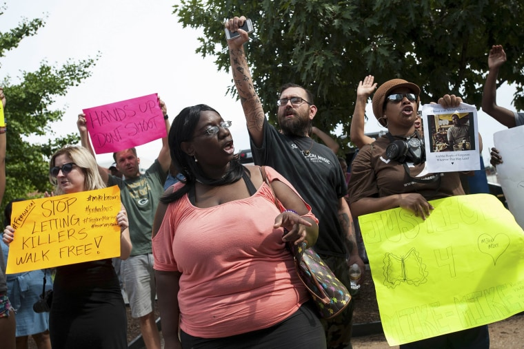 "Image: Protestors continued ""no justice, no peace"" chants at the St. Louis County Justice Center in Clayton"