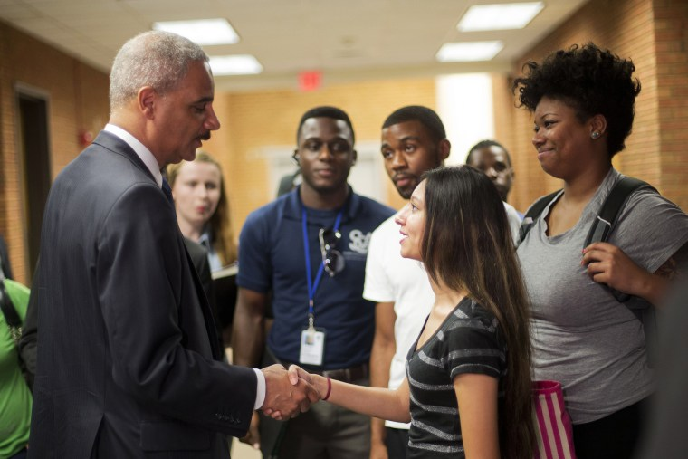 Attorney General Eric Holder shakes hands with Bri Ehsan, 25, following his meeting with students at St. Louis Community College Florissant Valley in Ferguson, Missouri August 20, 2014.