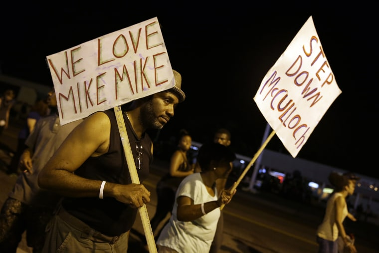 Protesters march Thursday, Aug. 21, 2014, in Ferguson, Mo.