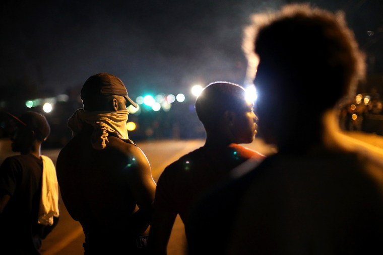 Demonstrators protest the killing of teenager Michael Brown on Aug. 12, 2014 in Ferguson, Mo.
