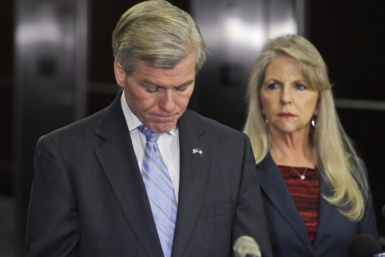 Former Virginia Gov. Bob McDonnell pauses while making a statement as his wife, Maureen, right, listens during a news conference in Richmond, Va., Jan. 21, 2014.