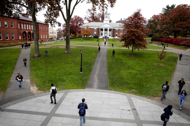 Passersby on campus at Amherst College.