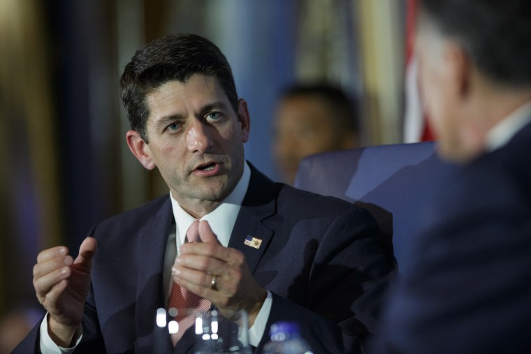U.S. Rep. Paul Ryan (R-WI) answers a question while he is interviewed by former Republican presidential candidate Mitt Romney in Chicago, Aug. 21, 2014.
