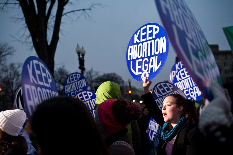 Pro-choice activists hold a vigil outside the U.S. Supreme Court on Jan. 23, 2012 in Washington, DC.