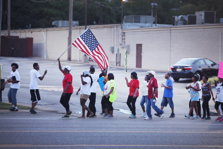 Demonstrators protest the death of Michael Brown on August 22, 2014 in Ferguson, Missouri.