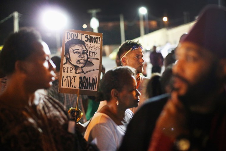 Demonstrators protest the shooting death of Michael Brown on Aug. 23, 2014 in Ferguson, Mo.
