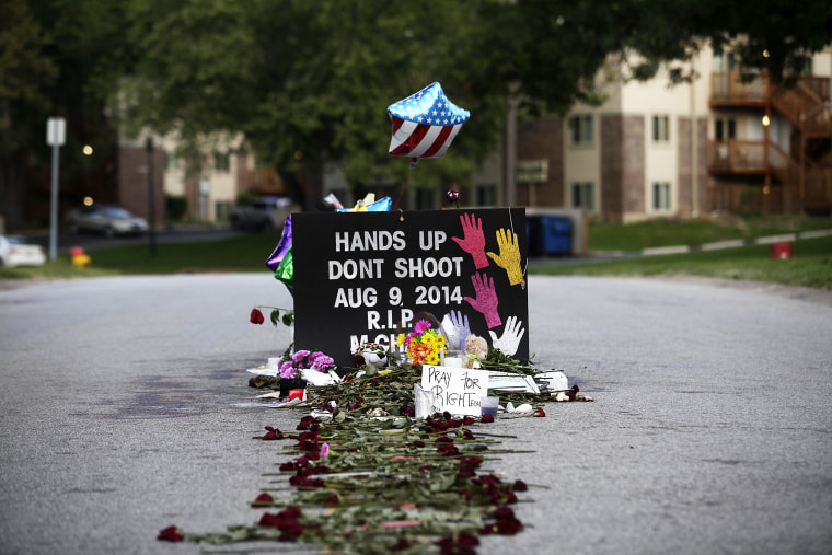 Roses line the street leading to a makeshift memorial for Michael Brown on Aug. 22, 2014 in Ferguson, Mo.