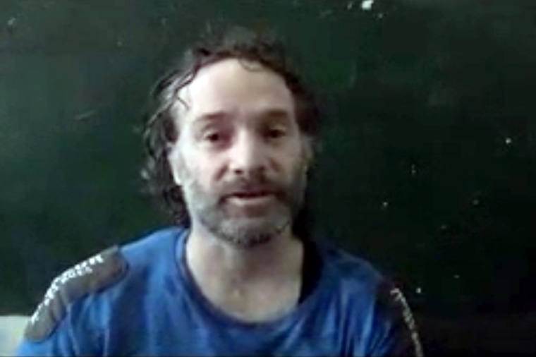 In this image made from undated video obtained by The Associated Press, which has been authenticated based on its contents and other AP reporting, a man believed to be Peter Theo Curtis, a U.S. citizen held hostage by an al-Qaida linked group in Syria, de
