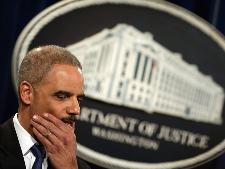 File Photo: U.S. Attorney General Eric Holder holds a news conference about efforts by the Justice Department and the Health and Human Services Department to combat Medicare fraud at the Justice Department May 14, 2013 in Washington, DC. (Photo by Chip...