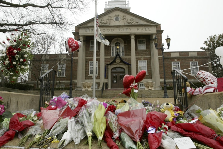 In this Feb. 8, 2008 file photo, a memorial for those killed in a shooting rampage is seen outside City Hall where a gunman opened fired the day before in Kirkwood, Mo.
