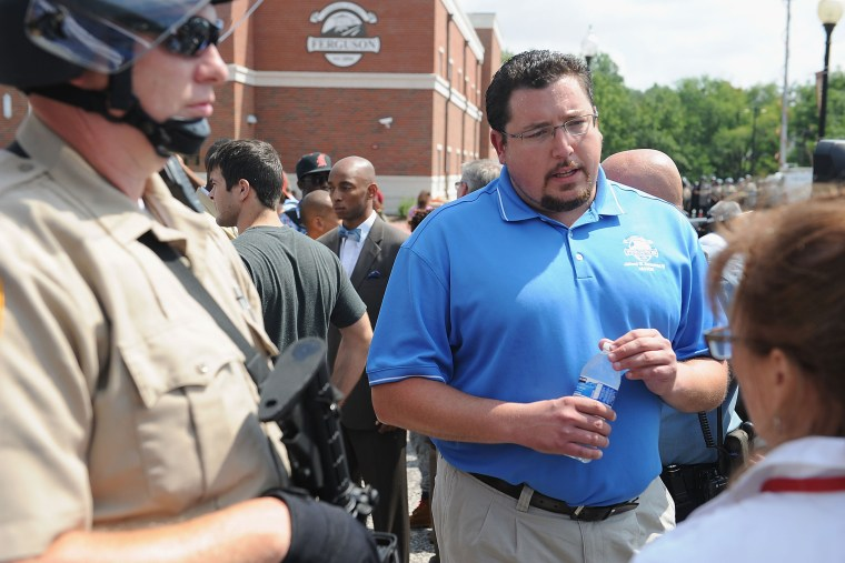 Ferguson Mayor James Knowles III (C) speaks to protestors during a protest of the shooting death of 18-year-old Michael Brown by a Ferguson police officer, outside Ferguson Police Department Headquarters Aug. 11, 2014 in Ferguson, Mo.