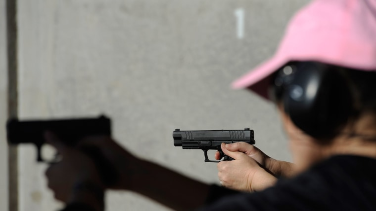 People shoot their guns at a shooting range in Tucson, Arizona.