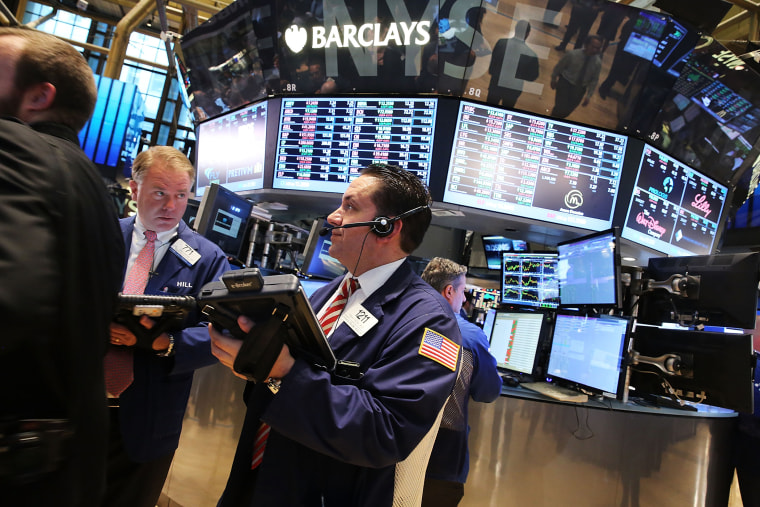 Traders work on the floor of the New York Stock Exchange (NYSE) on August 26, 2014 in New York City.