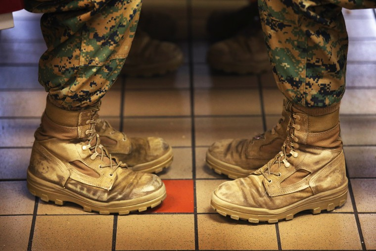 Marine recruits sit while having lunch during boot camp on February 26, 2013 at MCRD Parris Island, South Carolina.